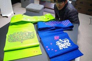 桃の節句や平成をモチーフにして住民グループが製作した帯(与謝野町加悦)