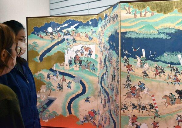 山崎合戦の様子が描かれた屏風絵 (京都府大山崎町・町歴史資料館)