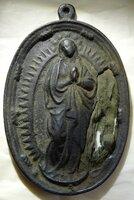 隠れキリシタンの遺物とみられるメダリオン(安土城考古博物館提供)